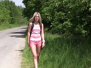 Horny blonde teen goddess masturbates besides a road