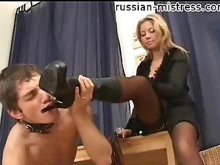 Mistress rubs her messy food on his face and makes him suck toes