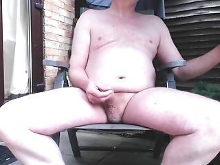 Wanking and cumming in the garden