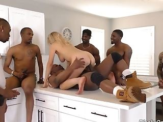 White housewife Erica Lauren is banged by several black workers