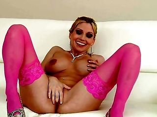 Blonde haired MILF Christie Stevens in beautiful pink stockings touches