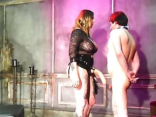 Wicked Domme humiliates a man with her huge strap-on dildo