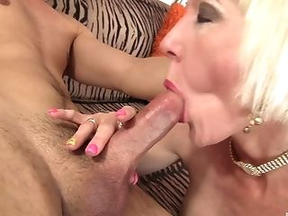 Older blonde chick and a hard pounding for her pussy on the couch