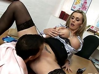 Boobalicious blond MILF Tanya Tate fucks with her kinky buddy on office table