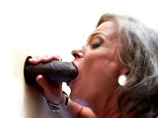 Granny with a grey hair goes crazy over the chocolate gloryhole cock
