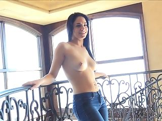 Alluring brunette eases off her jeans to masturbate sensually in a close up shoot