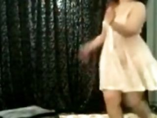 Chubby Egyptian girlfriend dancing seductively in white dress