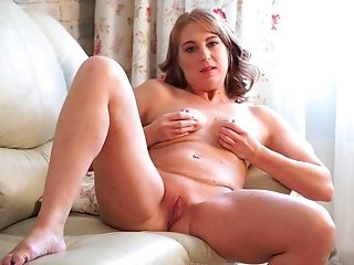 Mature woman Marta is masturbating her pussy spreading legs wide open